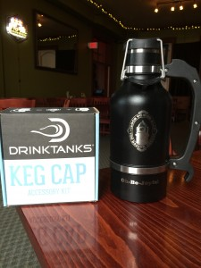 Black 64 oz Drink Tank growler, shown with the keg cap accessory kit which you can purchase separately